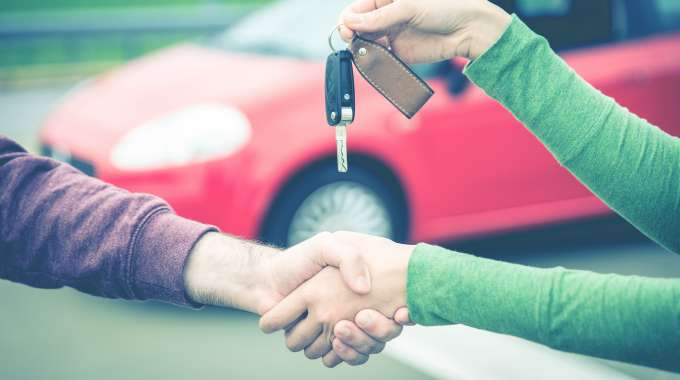Keys being exchanged in a private car sale.