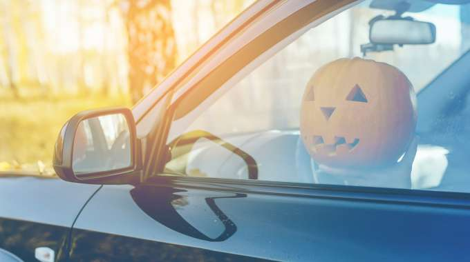 Pumpkin Driving a Spooky Halloween Car