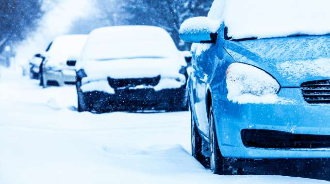 Snow-covered cars with winter tires