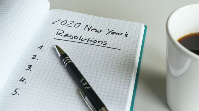 Someone writing down their new year resolutions