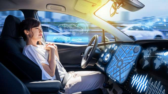 Woman in futuristic self driving car