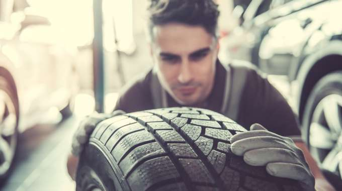 Mechanic Inspects Tire