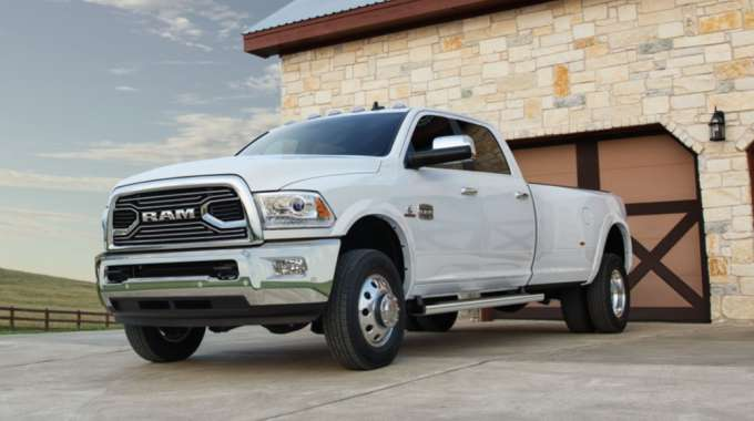 Recalled white Dodge Ram 3500 sits outside of a garage