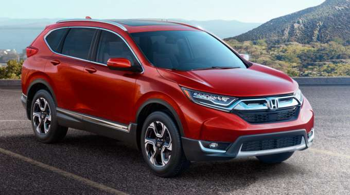 Recalled 2019 Honda CR-V Driving on Scenic Road.