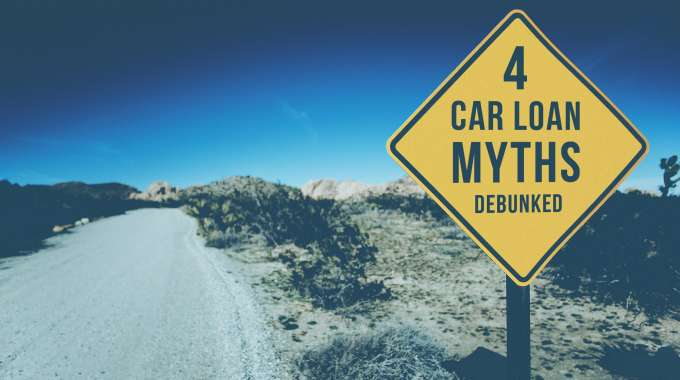 Traffic sign with the words '4 Car Loan Myths debunked', a warning for car shoppers about common promotions they'll see while shopping, and how to treat them