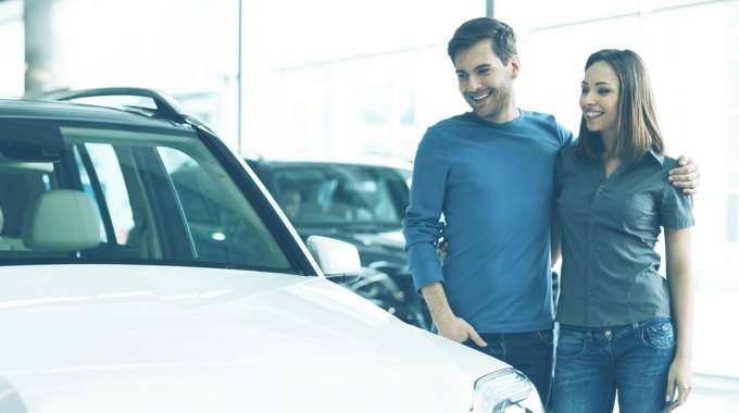 Couple looks at new SUV to lease for zero down