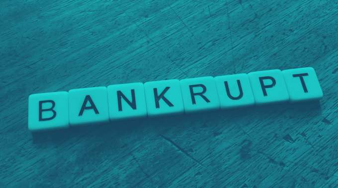 "Scrabble letters spelling out the word ""bankrupt"""