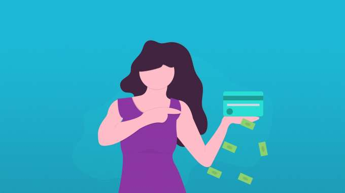 a woman holding a credit card