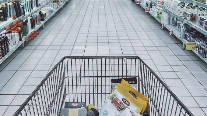 person grocery shopping using coupons