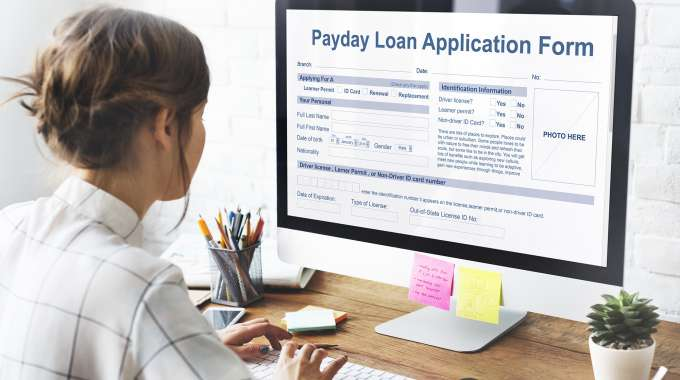 woman thinking about applying for a payday loan