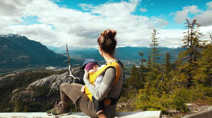 mother and baby looking out over Canadian landscape