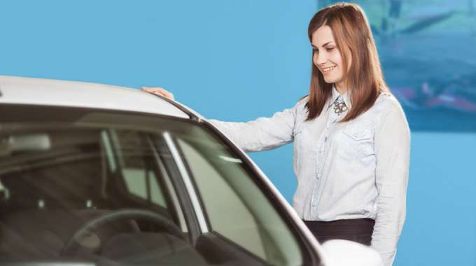 person examining a car they may buy now